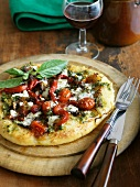 Pizza al pesto (basil pesto pizza with tomato, Italy)