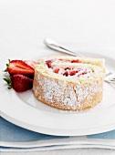 A slice of strawberry Swiss roll