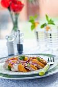 Chicken salad with orange salad, red onions and coriander