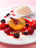 Summer fruits with berry sauce, lavender and vanilla ice cream