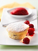 Raspberry souffle with raspberry sorbet