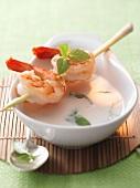 Thai soup with a prawn and lemongrass kebab