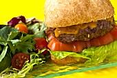 A cheeseburger with salad