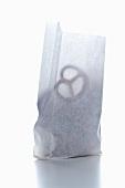 Salted pretzels in a paper bag