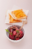 Peach puff pastry tartlets and raspberry ice cream with grated chocolate