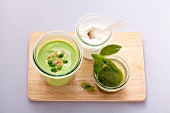 Iced pea soup with cottage cheese and mint oil