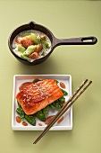 Salmon with cucumber in a creamy dill sauce and teriyaki salmon on mange tout