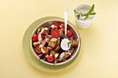 Aubergine and tomato stir fry with mint yogurt