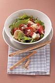 Tomato salad with rocket, bananas and Parmesan
