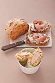 Carrot and pumpkin seed bread with herb quark and ham and salad wraps with chicken breast