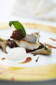 Fried bass with lentils, artichokes and sage