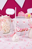 A white cake pop, heart-shaped biscuits and marshmallows