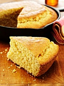 Slice of Corn Bread Cooked in a Cast Iron Skillet