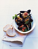 Mussels in a white wine reduction with celery, tomatoes and onions