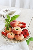 A fruit platter of peaches and raspberries