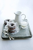 Doughnuts with coconut flakes and milk