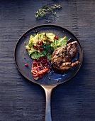 Pheasant breast with savoy cabbage and pomegranate seeds