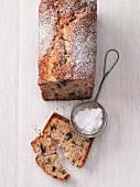 Chocolate and banana cake dusted with icing sugar