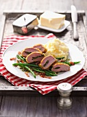 Saddle of lamb with mashed potatoes and green beans