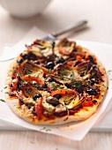Artichoke, olive and caper pizza