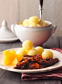 Duck with balsamic sauce, oranges and potato dumplings