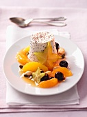 Carrot flan with exotic fruit salad