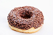 A doughnut with chocolate glaze and chocolate sprinkles