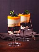 Layered dessert with vanilla cream and blueberries