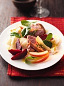 Duck fillet with vegetables and apple