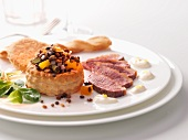 A vol-au-vent filled with lentil salad and duck breast