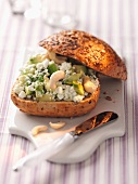 Cottage cheese, avocado and cashew nuts on a seed roll