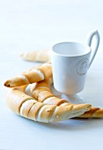 Salted pastries and a cup