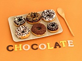 Six doughnuts and the word chocolate