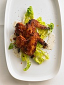 Chicken wings on a bed of lettuce