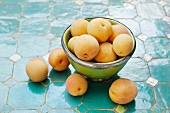 Apricots in a metal bowl and next to it