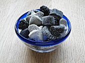 Liquorice sweets in a glass bowl