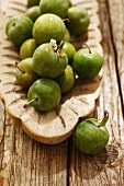 Greengages in a wooden bowl