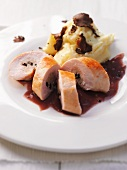 Truffled spring chicken breast with mashed potatoes and truffle slices