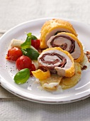 Chicken roulade au gratin filled with ham