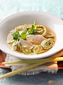 Lemongrass soup with chicken and pancake rolls