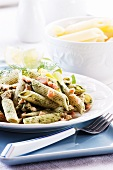 Penne with spinach sauce and diced salmon