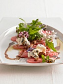 Veal carpaccio with gorgonzola and herb salad