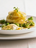 Ravioli filled with pecorino cheese on broad beans
