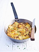 Potato tortilla in frying pan