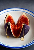 A fresh fig with honey