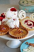 Caramelised lemon tarts and white chocolate & raspberry tarts