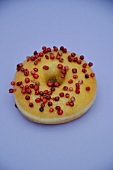 A doughnuts with pink peppercorns