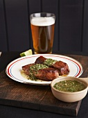 Tri-Tip Steak with a Green Peppercorn Sauce and a Glass of Beer