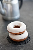 Two doughnuts with icing sugar