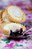 Shortbread tartlets with blueberry jam and vanilla cream